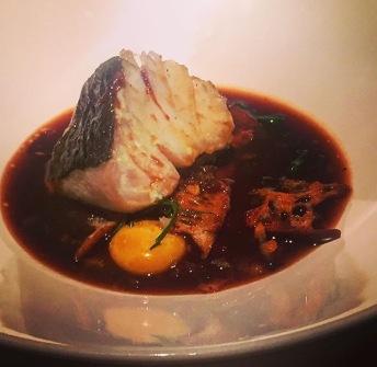 Bacalao asado con pisto manchego y yema de huevo